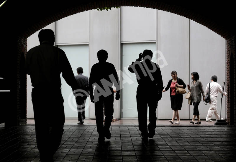 Businessmen walk back to the office after lunch time in Tokyo, Japan, 27 June 2014.  EPA/KIMIMASA MAYAMA