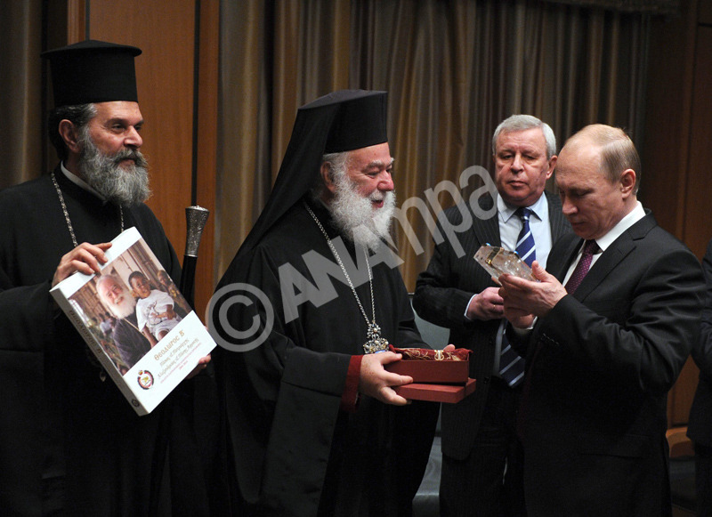 epa04612830 Russian President Vladimir Putin (R) meets with Theodore (Theodoros) II (2-L), the Eastern Orthodox Patriarch of Alexandria and All Africa, in Cairo, Egypt, 10 February 2015. Vladimir Putin is on a two-day visit in Egypt at the invitation of Egyptian President.  EPA/MIKHAIL KLIMENTYEV / RIA NOVOSTI / KREMLIN POOL MANDATORY CREDIT