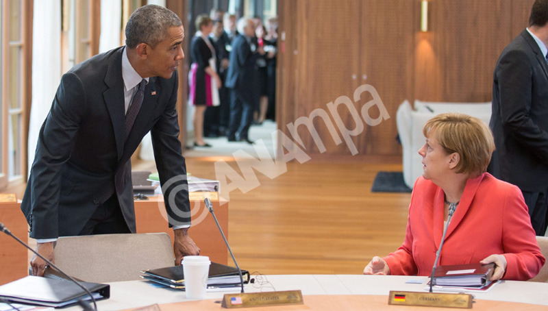 epa04789137 USPresident Barack Obama (L) German Chancellor Angela Merkel at Elmau Castle in Elmau, Germany, 08 June 2015, at the third session of the G7 meeting. Heads of state and government of the seven leading industrialized nations (G7) are scheduled to meet in Elmau Castle, Bavaria, on June 7-8 as the climax of Germany