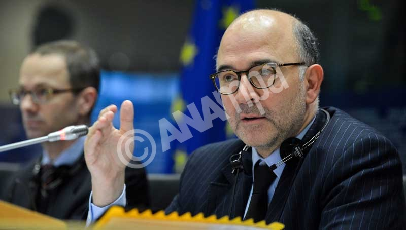 epa04511414 EU Commissioner for Economic and Financial Affairs, Taxation and Customs Pierre Moscovici speaks during a hearing at the EU Parliament in Brussels, Belgium, 02 December 2014. The hearing was on draft budgetary plans for the eurozone.  EPA/STEPHANIE LECOCQ