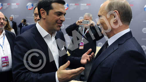 epa04808480 Russian President Vladimir Putin (R) speaks with Greek Prime Minister Alexis Tsipras (C) prior to a plenary session during the St. Petersburg International Economic Forum in St.Petersburg, Russia, 19 June 2015.  EPA/MIKHAIL KLIMENTIEV / RIA NOVOSTI / POOL Mandatory credit