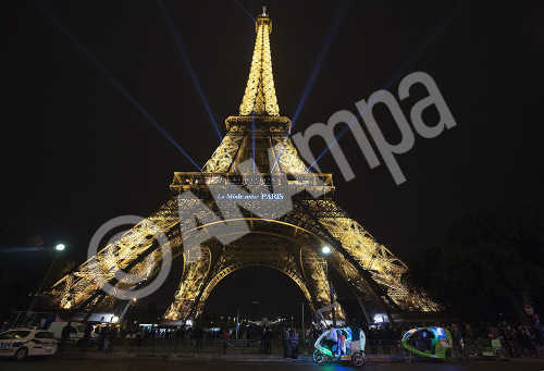 The lettering 'Fashion loves Paris' is projected onto the Eiffel Tower during the Paris Fashion Week Spring/Summer 2016 Ready to Wear collection, in Paris, France, 04 October 2015. The presentation of the Women's collections runs from 29 September to 07 October.  EPA/CAROLINE BLUMBERG