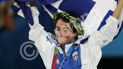 Greek gold medal winner Athanasia Tsoumeleka during the podium ceremony for the women's 20km Walk at the Athletics, Track and Field events at the Athens 2004 Olympic Games, 23 August 2004.