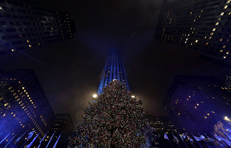 The Rockefeller Center Christmas Tree stands tall during the 84th annual lighting ceremony in New York, New York, USA, 30 November 2016. More than 50,000 multi-colored energy efficient LED (light-emitting diode) lights and other decorations are placed on the 94-foot-tall tree. The Rockefeller Center Christmas Tree is a New York institution and was started in 1933.  EPA/JASON SZENES