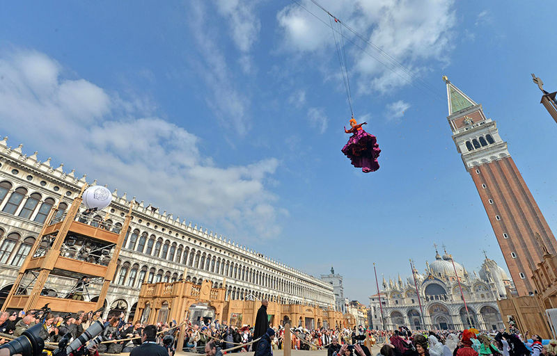 Claudia Marchiori, winner of last year's 'Maria of the Carnival' contest, descends from the Campanile (Bell Tower) in St Mark's Square during the traditional 'Volo dell'Angelo' (trans. Flight of the Angel) event that marks the official opening of the celebrations of St. Mark's Square at the Venice Carnival in Venice, northern Italy, 19 February 2017. The carnival season in the historical lagoon city attracts revellers from around the world every year.  EPA/ANDREA MEROLA